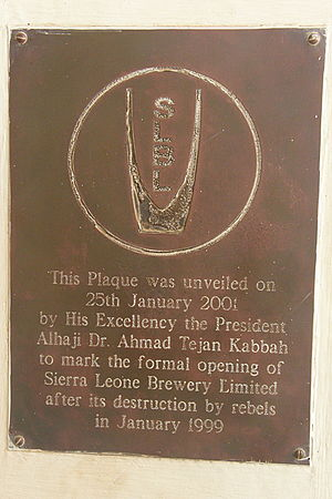 Sierra Leone Brewery Limited - A brass plaque recording the re-opening of the Sierra Leone Brewery by Ahmad Tejan Kabbah after the destruction of the brewery by rebels in the civil war.