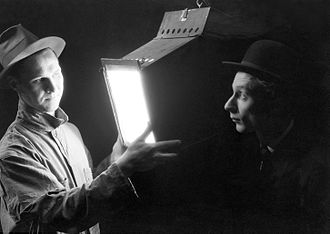 Federal Theatre Project - The Man Who Knows All (Robert Noack) explains the kilowatt hour to the Consumer (Norman Lloyd) in the Living Newspaper play, Power (1937)