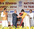 Pranab Mukherjee presenting the National Award for Teachers-2014 to Smt. Chungkipa Lepcha, Sikkim, on the occasion of the 'Teachers Day', in New Delhi. The Union Minister for Human Resource Development, Smt. Smriti Irani.jpg