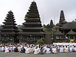 A Hindu Dharma prayer ceremony at Bali's Bekasih Temple.