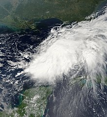 Satellite image of a large area of clouds over the Gulf of Mexico, elongated from upper-right to bottom-left.