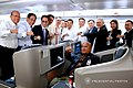 President Rodrigo Roa Duterte flashes his signature pose with the members of his delegation while on board Philippine Airlines chartered flight PR001 bound for New Delhi.jpg