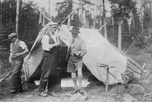 Royal tours of Canada by the Canadian Royal Family - The Prince of Wales, talks with river guide Neil McDougall at their camp on the Nipigon River, 1919