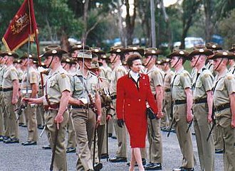 Monarchy of Australia - The Princess Royal passes behind the Princess Anne Banner at a parade for the 75th anniversary of the Royal Australian Corps of Signals