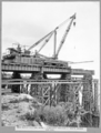 Queensland State Archives 3584 Main bridge erection stage 1 temporary erection of north anchor arm deck Brisbane 15 September 1937.png
