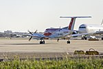 RFDS (VH-NAO) Beechcraft B350C King Air on DOM6 at Sydney Airport.jpg