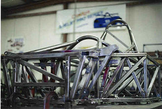 Shelby Can-Am - A Shelby Can Am tube frame chassis on the surface plate at Racefab Inc.