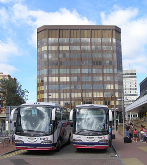 RailAir - First Berkshire coaches in front of the Thames Tower on the Reading to Heathrow Airport service