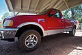 Red Ford F-150 XLT of the tenth generation on Mesa AP tires (4890241876).jpg