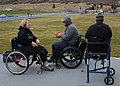 Retired U.S. Navy Master-at-Arms Seaman Steve Hancock, center, a Navy-Coast Guard team member, talks with a British wounded warrior during track and field practice in preparation for the 2013 Warrior Games 130509-N-DT940-240.jpg