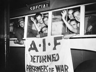 Demobilisation of the Australian military after World War II - Former prisoners of war wave from the bus which took them to the Royal Agricultural Showgrounds after arriving at Central Station in Brisbane