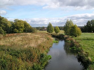 Penkridge - The River Penk, from Bull Bridge on the northern edge of the historic centre. The Roller Mill is visible in the distance: the Penk was long an important energy source for the town.