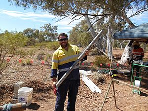 Engineering geology - An engineering geologist logging rock core in the field, Western Australia.