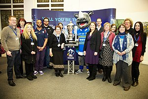 2013 Rugby League World Cup - Representatives of the game with the trophy at Leeds Central Library.