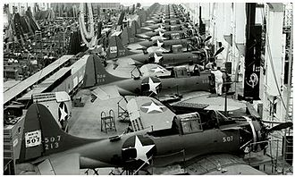 Dive bomber - Final assembly view of SBD Dauntless dive bombers in 1943 at the Douglas Aircraft Company plant in El Segundo, California. The dive brakes are visible behind the wings.