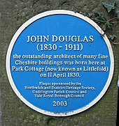 "A circular blue plaque reading ""JOHN DOUGLAS (1830–1911 the outstanding architect of many fine Cheshire buildings was born here at Park Cottage (now known as Littlefold) on 11 April 1830. Plaque sponsored by the Northwich and District Heritage Society, Cuddington Parish council and Vale Royal Borough Council 2003"