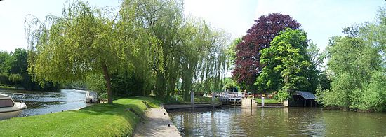 Wild swimming at Shiplake Lock from downstream with the weir stream to the left