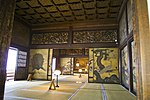 Three tatami matted rooms separated by sliding doors decorated with bird and plant motifs.