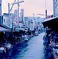 Shopping street near Shōmen Bridge over Kamo River, Kyoto (1967-05-09 by Roger W).jpg