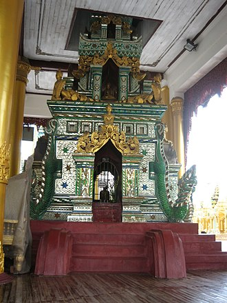 Glass mosaic - a well in Shwedagon Pagoda is embellished with glass mosaic.