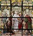 Sint-Laurentiuskerk (Lokeren) - Glasraam - De H. Laurentius helpt de armen (detail).JPG