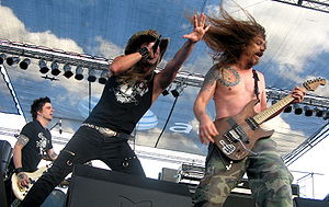 Skid Row (American band) - Skid Row performing at the South Texas Rockfest in 2008. From left to right: Rachel Bolan, Johnny Solinger, and Scotti Hill.