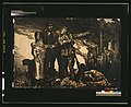 Soldier giving direction to a family, amid chaos and destruction of war LCCN2003668495.jpg