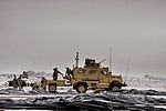 Soldiers from Task Force Currahee, 4th Brigade, 101st Airborne Division, recover bundles of fuel on January 29, 2011 at Forward Operating Base Waza, K'wah, Afghanistan.jpg