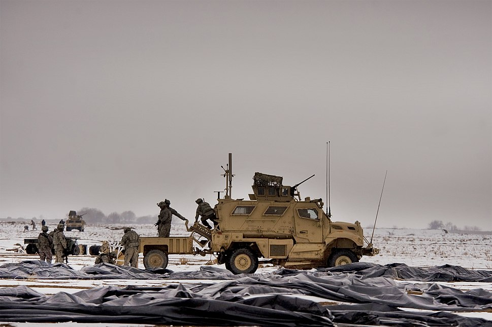 Soldiers from Task Force Currahee, 4th Brigade, 101st Airborne Division, recover bundles of fuel on January 29, 2011 at Forward Operating Base Waza, K'wah, Afghanistan