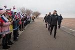 Soyuz MS-11 crew members at the airport in Baikonur.jpg