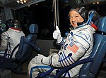 Soyuz TMA-5 crew ride in a bus to the launch pad.jpg