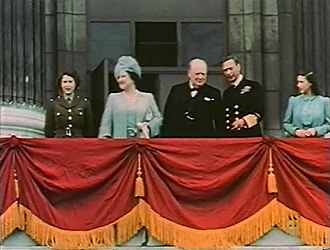Elizabeth II - Elizabeth (far left) on the balcony of Buckingham Palace with her family and Winston Churchill on 8 May 1945, Victory in Europe Day