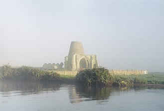 St Benet's Abbey - Gatehouse of St Benet's Abbey in the early morning mist, October 2004. The conical structure is the remains of the later windmill built  inside it