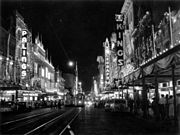 StateLibQld 1 110000 Queen Street, Brisbane, with decorations for the royal visit in 1954