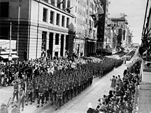 Queensland-20th century-StateLibQld 1 114168 Returned World War Two soldiers march in Queen Street, Brisbane, 1944