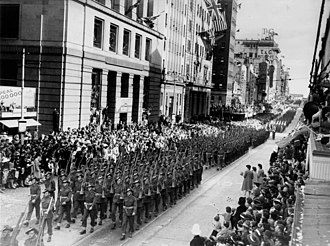 Queensland - Returned World War II soldiers march in Queen Street, Brisbane, 1944