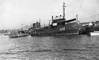 StateLibQld 1 123333 Tugboat, Alma lying at Cooktown, 1946.jpg