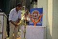 Subhashish Panigrahi lighting lamp during Odia Wikisource Sabha 2014, Bhubaneswar 10.jpg