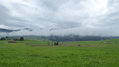 Swiss landscape with clouds.png