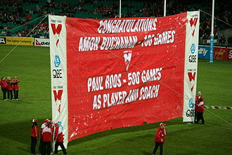 Sydney Swans - A Sydney Swans banner honouring Amon Buchanon's 100th game as a player Paul Roos' 500th game as player and coach