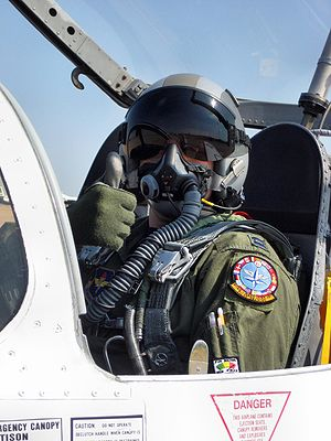 Oxygen mask - A T-37 pilot wearing a mask designed for both diluter- and pressure-demand breathing