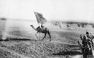 Battle of Aqaba - A flag bearer mounted on a camel leading the triumphal entry into Akaba