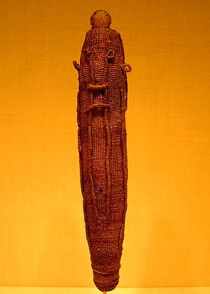 Polynesian narrative - A sacred god figure wrapping for the war god 'Oro, made of woven dried coconut fibre (sennit), which would have protected a Polynesian god effigy (to'o), made of wood.