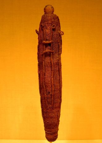 Polynesian narrative - A sacred god figure wrapping for the war god 'Oro, made of woven dried coconut fibre (sennit), which would have protected a Polynesian god effigy (to'o), made of wood
