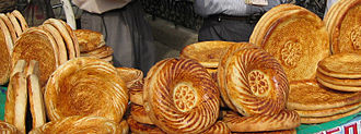 Tajik cuisine - A selection of traditional non at the market.