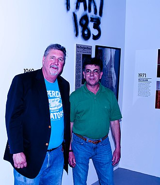 TAKI 183 - TAKI 183 (right) at a 2010 gallery event with his tag visible on the wall behind