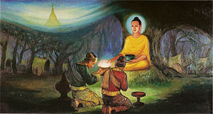 Singuttara Hill - A painting depicting Tapussa and Bhallika receiving strands of hair from the Buddha.
