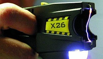 A TASER device, with cartridge removed, making an electric arc between its two electrodes Taser-x26.jpg