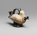 Terracotta askos (flask with a spout and handle over the top) in the form of a duck MET DP145542.jpg