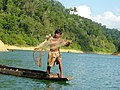 Thai fisherman casts his net.JPG